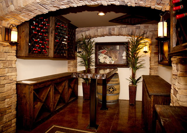 Walking into John Morris' home, there's a glass panel on the floor that looks to his wine cellar in the basement. (TONYA HARVEY/REAL ESTATE MILLIONS)