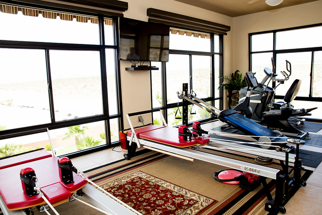 One of the patios off the master bath is enclosed and houses workout equipment. (Tonya Harvey/Real Estate Millions)