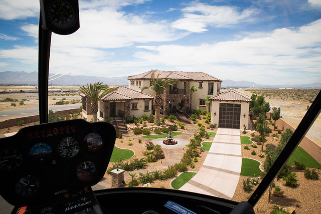 Developer John Morris takes his helicopter for a spin. When it isn't on the roof of his house, it's stashed in his 1,100-square-foot recreational vehicle garage on the right side of his home. (Ton ...