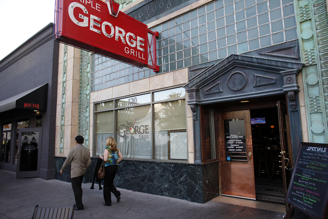 A couple walks out of the Triple George Grill in downtown Las Vegas  Saturday, April 28, 2012. (John Locher/Las Vegas Review--Journal)