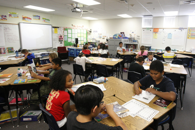 Fifth grade students read books inside their classroom at Wright Elementary School in Las Vegas Friday, Sept. 19, 2014.  (Erik Verduzco/Las Vegas Review-Journal)