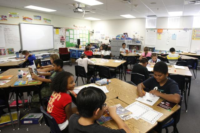 Fifth grade students read books inside their classroom at Wright Elementary School in Las Vegas Friday, Sept. 19, 2014.  (Erik Verduzco/Las Vegas Review-Journal)