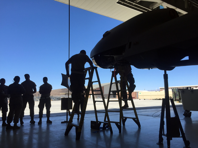 "Airmen assemble the airframe for an MQ-9 Reaper remotely piloted aircraft Tuesday, June 16, 2015 inside a hangar at Creech Air Force Base, 45 miles northwest of Las Vegas. ""It's not a dro ..."