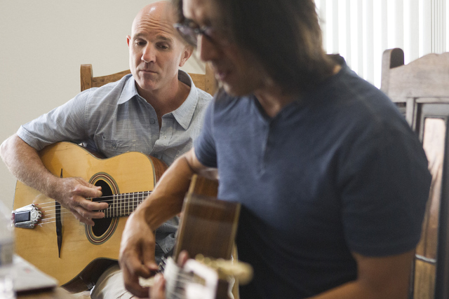 "Hot Club of Las Vegas guitarists Johnny Miles, left, and Mundo Juillerat review a chord change during rehearsal for the ""DjangoVegas!"" concert Saturday at the Historic Fifth Street School. Erik Ve ..."