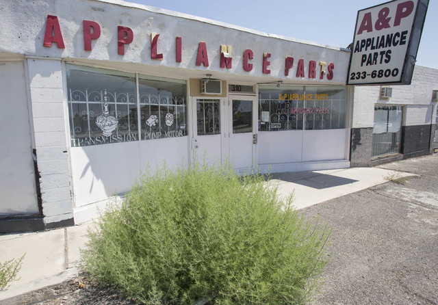 An oversized bush grows through the asphalt outside the A&P Appliance Parts store located at 310 East Lake Mead Blvd. in North Las Vegas on Thursday, June 23, 2016. (Richard Brian/Las Vegas Re ...