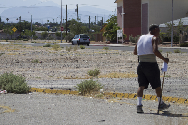 A man walks on a dirt lot near Lake Mead Boulevard and Las Vegas Boulevard on Saturday, June 25, 2016, in North Las Vegas. Erik Verduzco/Las Vegas Review-Journal Follow @Erik_Verduzco