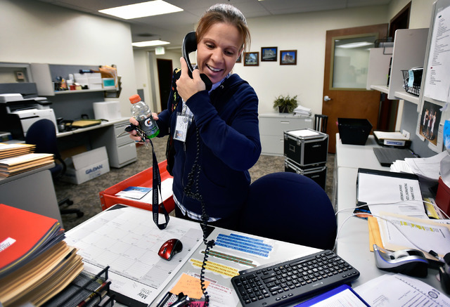 Drug court coordinator Melissa Mevis takes a phone call at her desk at Nye County Fifth Judicial District Court in Pahrump on Wednesday, May 18, 2016. Mevis, a 2006 drug court graduate, has been w ...
