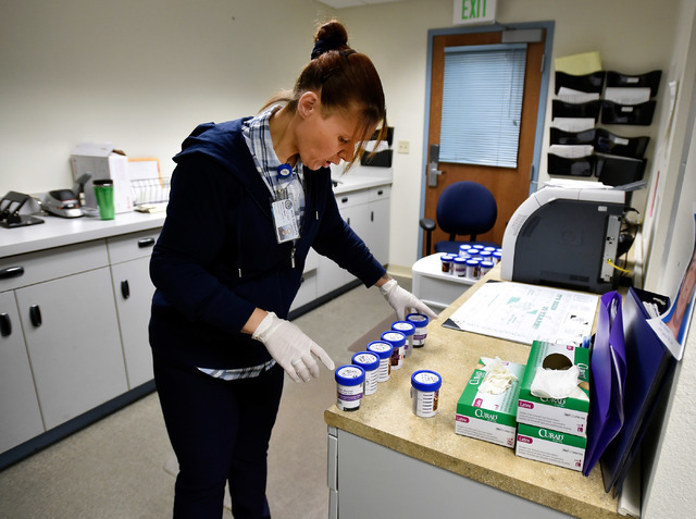 Drug court coordinator Melissa Mevis sorts urine collection jars at Nye County Fifth Judicial District Court in Pahrump on Wednesday, May 18, 2016. Mevis, a 2006 drug court graduate, has been work ...