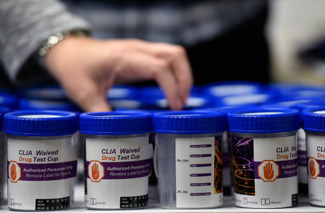 Urine sample containers are lined up for the daily collection at the drug court at the Fifth Judicial District Court Wednesday, May 18, 2016 in Pahrump. (David Becker/Las Vegas Review-Journal) Fol ...