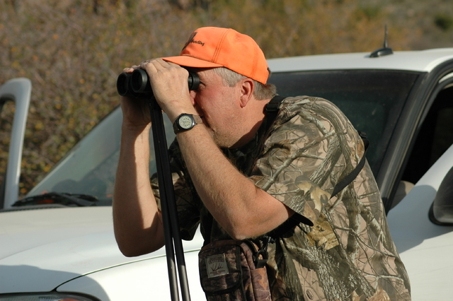 It never hurts to have an extra pair of eyes during any big game hunt. Don Nash of Alamo searches for deer during a hunt with friends in a year when he didn't have a tag himself. (Doug Nielsen/Spe ...