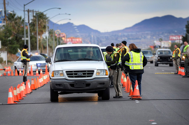 Las Vegas police officer Beth Choat speaks with a driver at a DUI checkpoint along Boulder Highway on Feb. 2, 2014. (David Becker/Las Vegas Review-Journal)