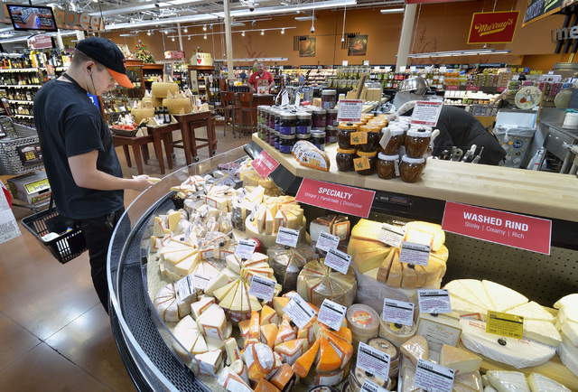 Chris Compton checks out the selection at the Murray's Cheese counter at Smith's at 7130 N. Durango Drive in Las Vegas on Friday, June 17, 2016. Bill Hughes/Las Vegas Review-Journal