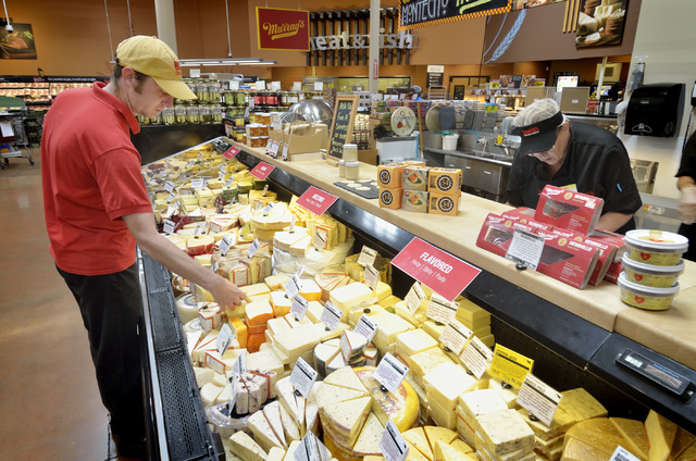 Charles Reisner, cheese master for Murray's Cheese at Smith's, is shown arranging his products at the store at 7130 N. Durango Drive in Las Vegas on Friday, June 17, 2016. Bill Hughe ...