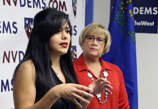 Attorney, Jessica Cruz, speaks as NVDEMS Chair Roberta Lange, right, looks on Monday, June 6, 2016, during a press conference to respond to Donald Trump's attacks accusing U.S. District Judge Gonz ...
