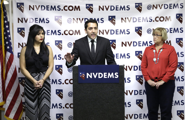 Assemblyman Nelson Araujo, flanked by attorney, Jessica Cruz, left, and NVDEMS Chair Roberta Lange, speaks on Monday, June 6, 2016, during a press conference to respond to Donald Trump's attacks a ...