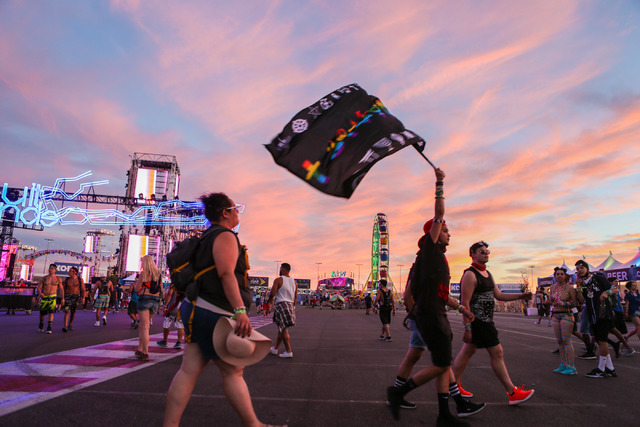 Attendees of the Electric Daisy Carnival at the Las Vegas Motor Speedway in Las Vegas arrive to the festival Friday evening and are greeted with a vibrant sunset amidst the heat, music and lights, ...