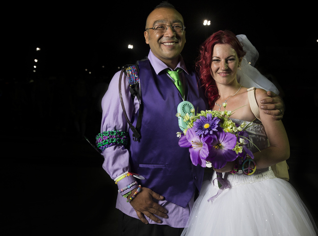 Ruben and Stephanie Cabrales were married at Electric Daisy Carnival on Friday, June 17, 2016 at Las Vegas Motor Speedway in Las Vegas. Benjamin Hager/Las Vegas Review-Journal