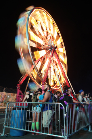 Festival goers wait to ride an observation wheel during the first night of the Electric Daisy Carnival Saturday, June 20, 2015 at the Las Vegas Motor Speedway.  (Sam Morris/Las Vegas Review-Journa ...