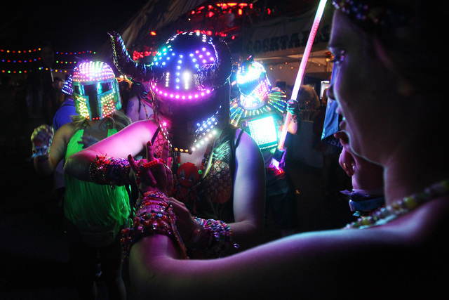 Festival goers trade bracelets during the first night of the Electric Daisy Carnival Friday, June 19, 2015, at the Las Vegas Motor Speedway.  (Sam Morris/Las Vegas Review-Journal) Follow Sam Morri ...