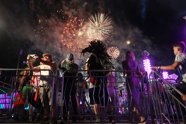 People take photos of a fireworks show during the first night of the Electric Daisy Carnival Saturday, June 20, 2015 at the Las Vegas Motor Speedway.  (Sam Morris/Las Vegas Review-Journal) Follow  ...