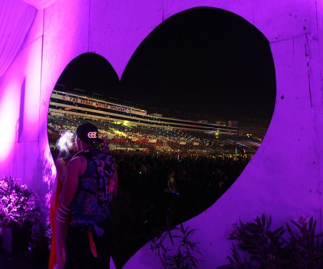 A couple kisses for a photo in a chapel during the first night of the Electric Daisy Carnival Saturday, June 20, 2015, at the Las Vegas Motor Speedway.  (Sam Morris/Las Vegas Review-Journal) Follo ...