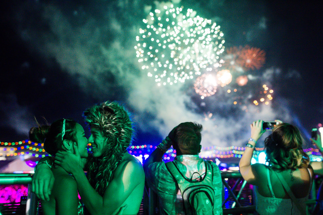 Yuri Naito and Jorge Martinez embrace as fireworks go off at Electric Daisy Carnival at the Las Vegas Motor Speedway in Las Vegas during the early hours of Sunday, June 21, 2015. (Chase Stevens/La ...
