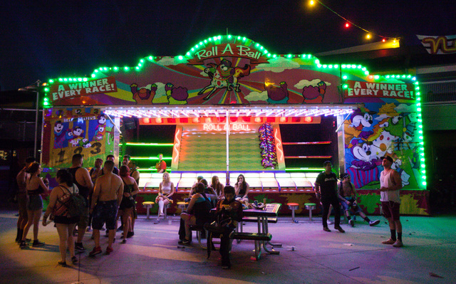 Attendees relax in the carnival square area at Electric Daisy Carnival at the Las Vegas Motor Speedway in Las Vegas during the early hours of Sunday, June 21, 2015. (Chase Stevens/Las Vegas Review ...