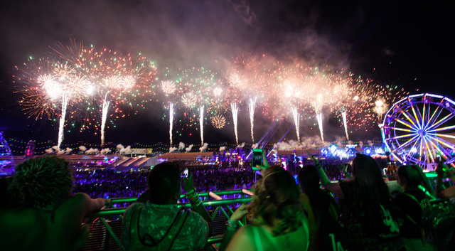 Attendees watch the fireworks show at Electric Daisy Carnival at the Las Vegas Motor Speedway in Las Vegas during the early hours of Sunday, June 21, 2015. (Chase Stevens/Las Vegas Review-Journal) ...