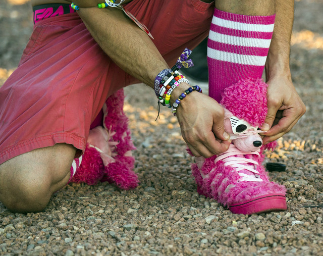 Jared Williams ties his shoe outside the Las Vegas Motor Speedway at end of the three-day Electric Daisy Carnival on Monday, June 20, 2016. (Jeff Scheid/Las Vegas Review-Journal Follow @jlscheid)