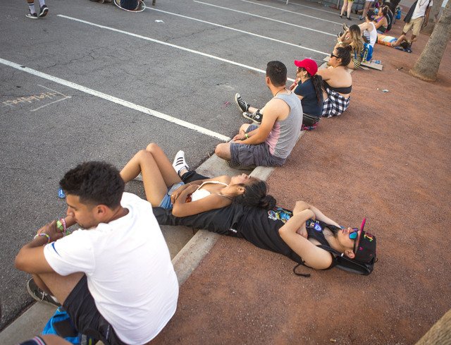 People relax at the Las Vegas Motor Speedway after the completion of the three-day Electric Daisy Carnival on Monday, June 20, 2016. (Jeff Scheid/Las Vegas Review-Journal Follow @jlscheid)