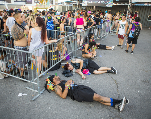 People sleep near the lost and found at the Las Vegas Motor Speedway after the completion of the three-day Electric Daisy Carnival on Monday, June 20, 2016. (Jeff Scheid/Las Vegas Review-Journal F ...