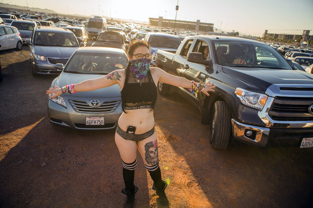 Bri Heath directs traffic at the Las Vegas Motor Speedway after the end of the three-day Electric Daisy Carnival on Monday, June 20, 2016. (Jeff Scheid/Las Vegas Review-Journal Follow @jlscheid)