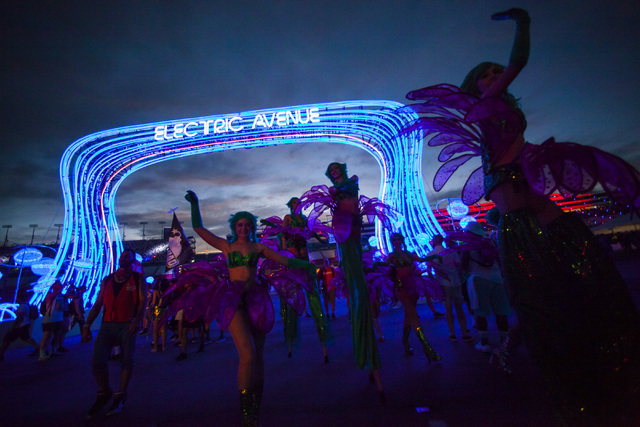 Costumed performers make their way through the festival grounds during the first night of Electric Daisy Carnival at the Las Vegas Motor Speedway in Las Vegas on Friday, June 17, 2016. (Chase Stev ...