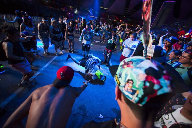 Kevin Quach of San Diego, Calif., break dances at the Circuit Ground stage during the first night of Electric Daisy Carnival at the Las Vegas Motor Speedway in Las Vegas on Friday, June 17, 2016.  ...