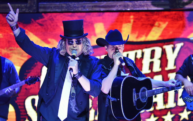 "Jeff Fairchild, left, performs as Big Kenny and Leonard Quenneville as John Rich during the Big and Rich segment of ""Country Superstars"" at the V Theater in the Miracle Mile Shop ..."