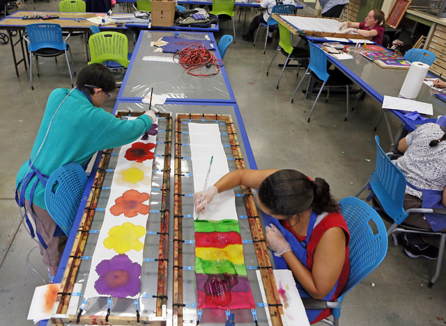 Hand-painted scarves are among the items set to be sold at ART: abOVe & BEYOND, an event scheduled June 29 at Opportunity Village's Ralph & Betty Engelstad Campus, 6050 S. Buffalo Drive. ...