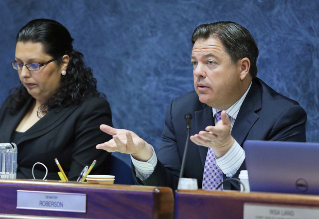Senator Michael Roberson, right, directs questions near Assemblywoman Olivia Diaz during a legislative advisory committee gathering at Grant Sawyer Building Thursday, June 16, 2016, in Las Vegas.  ...