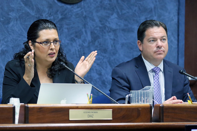 Assemblywoman Olivia Diaz, left, directions questions near Senator Michael Roberson during a legislative advisory committee gathering at Grant Sawyer Building Thursday, June 16, 2016, in Las Vegas ...