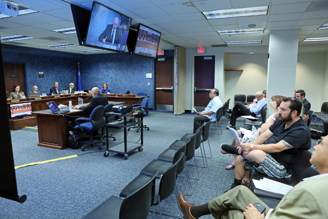 Michael Strembitsky, left, a retired superintendent of Edmonton Public Schools in Canada, speaks to a legislative advisory committee at Grant Sawyer Building Thursday, June 16, 2016, in Las Vegas. ...