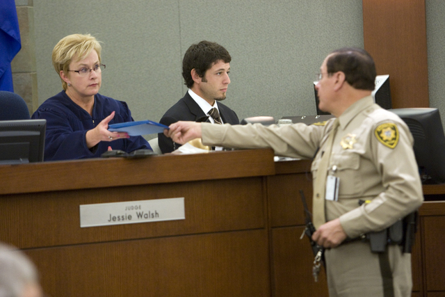 K.M. CANNON/LAS VEGAS REVIEW-JOURNAL Judge Jessie Walsh, left, receives the verdict from bailiff Matt Diamond Wednesday, May 5, 2010, after a jury found two drug companies liable for the hepatitis ...