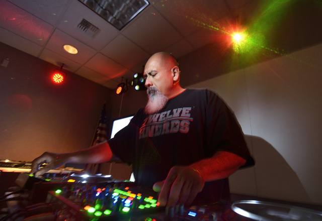 Salvador Avila, branch manager of the Las Vegas-Clark County Library District's Enterprise Library, works a deck during the Learn to DJ program at the library at 25 E. Shelbourne Ave. Bill Hughes/ ...