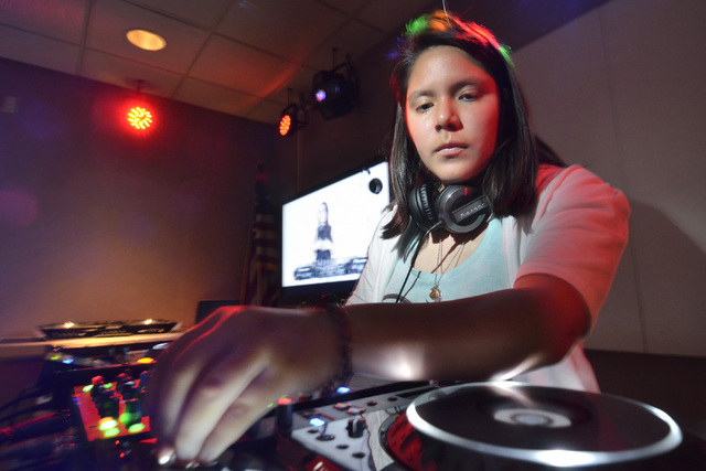 Jasmine Martinez, aka DJ Echoshake, works one of the decks at the Learn to DJ program at the Las Vegas-Clark County Library District's Enterprise branch at 25 E. Shelbourne Ave. in Las Vegas on Tu ...