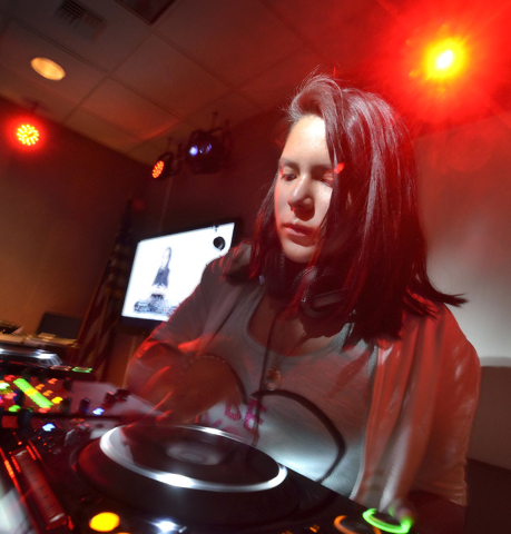 Jasmine Martinez, aka DJ Ecoh Shake, works one of the decks at the Learn to DJ program at the Las Vegas-Clark County Library District's Enterprise branch at 25 E. Shelbourne Ave. Bill Hughes/Las V ...