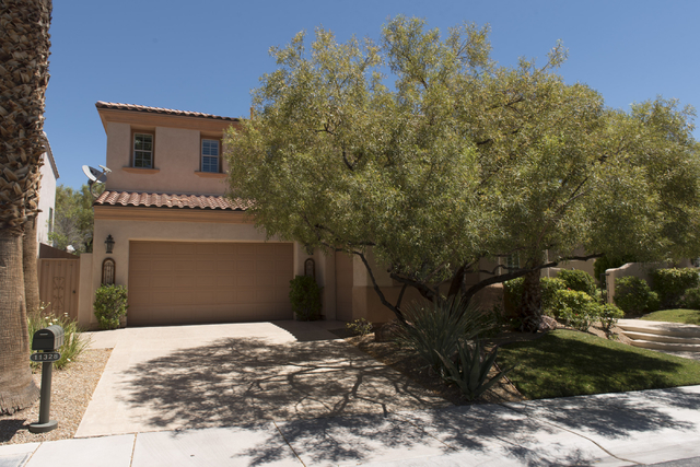A home at 11328 Golden Chestnut Place in Las Vegas is seen Friday, June 17, 2016. The home was purchased in 2005 for $1,275,000 and is now on the market for $950,000. Jason Ogulnik/Las Vegas Revie ...