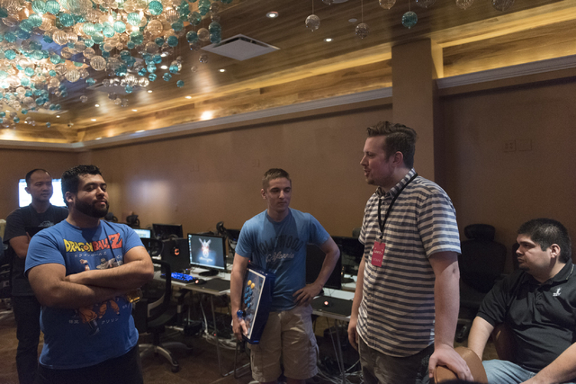Carson Knuth, co-founder of Leet, second from right, speaks with Street Fighter V tournament competitors at the Downtown Underground e-sports lounge at Downtown Grand hotel-casino in Las Vegas on  ...