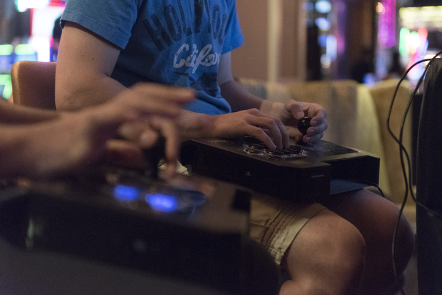 Steven Linakis, right, and Edgar Briangas, compete in the Street Fighter V tournament at the Downtown Underground e-sports lounge at Downtown Grand hotel-casino in Las Vegas on Friday, June 3, 201 ...