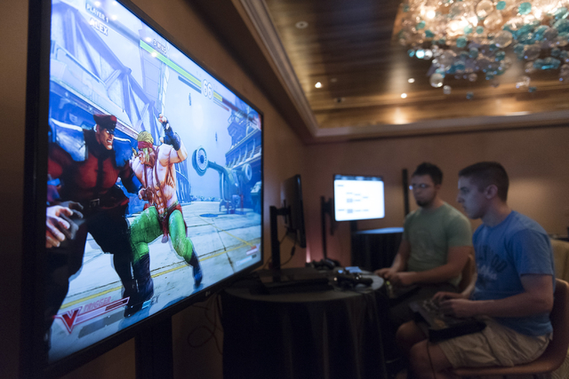 Edgar Briangas, left, and Steven Linakis, compete in the Street Fighter V tournament at the Downtown Underground e-sports lounge at Downtown Grand hotel-casino in Las Vegas on Friday, June 3, 2016 ...