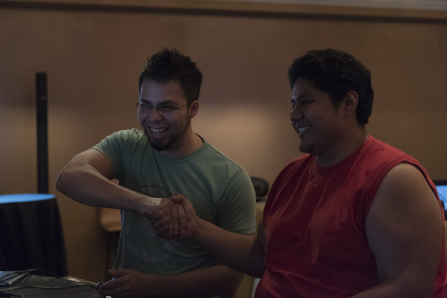 Edgar Briangas, left, and Angel Trejo compete in the Street Fighter V tournament at the Downtown Underground e-sports lounge at Downtown Grand hotel-casino in Las Vegas on Friday, June 3, 2016. Ja ...