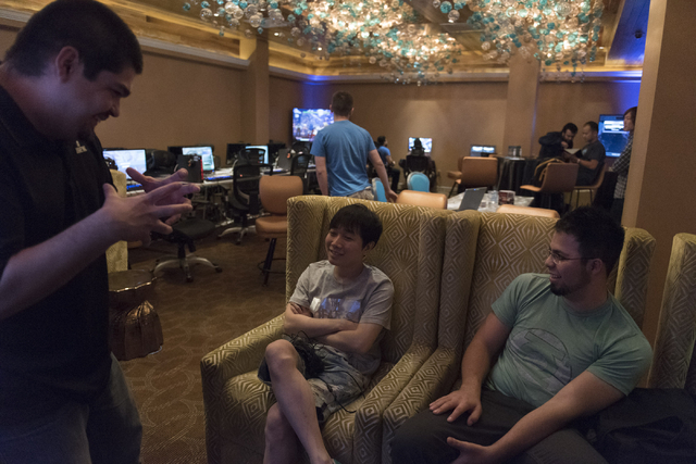 Isaac Perez, left,  talks with Yong Shin, center, and Edgar Briangas, after winning the Street Fighter V tournament at the Downtown Underground e-sports lounge at Downtown Grand hotel-casino in La ...