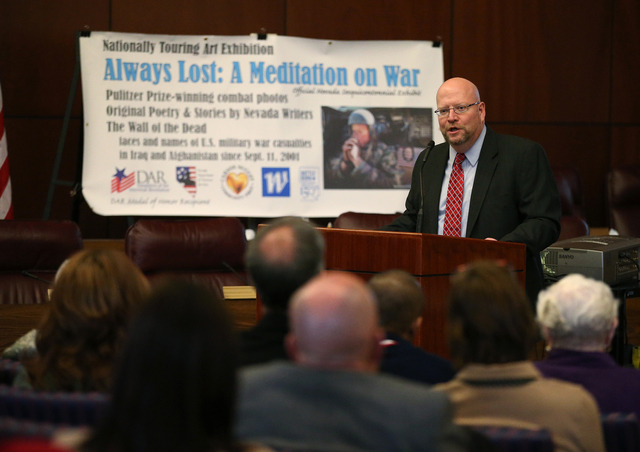 Legislative Counsel Bureau Director Rick Combs speaks at the opening ceremony of the Always Lost: A Meditation on War exhibit at the Legislative Building in Carson City, Nev., on Monday, April 6,  ...